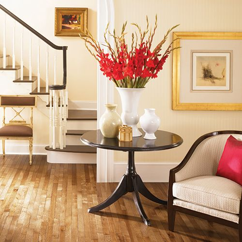 Beautiful light honey hardwood floors in foyer with furniture accents