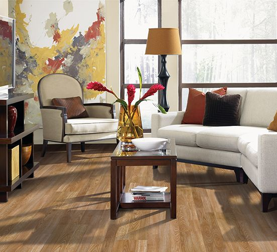 Warm laminate floors in a trendy mid-century modern living room